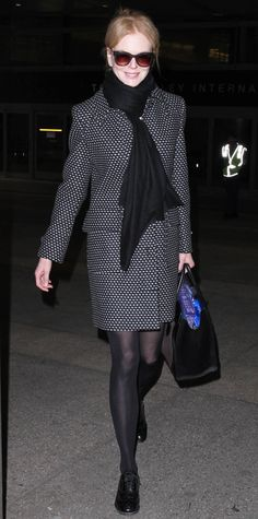 Nicole Kidman suited up for her LAX travels in a sleek polka-dot coat, black scarf, and oxfords (and toted a Celine purse).