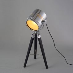 Industrial Loft Metal Searchlight Black Wood Tripod 1-Light Table Lamp, a perfect choice for your favorite reading area, office and more.