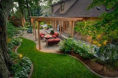 Pergola, patio, and clean landscape borders