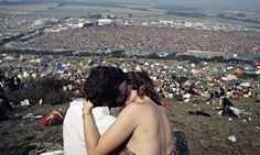 A couple kiss as 600,000 revellers attend the 1970 Isle of Wight festival.