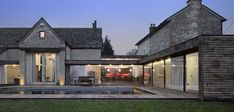 Example of flexibiliity of modern farmhouse design. Easy to incorporate modern windows and other elements - DV Contemporary Farmhouse Exterior, Farmhouse Architecture, Modern Farmhouse Design, Modern Exterior, Exterior Design, Modern Architecture, Cottage Extension, Style Deco, Stone Houses