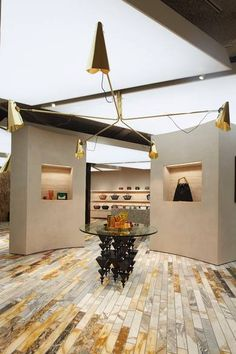 Fos table and central chandelier in Celine store