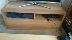 solid oak tv unit, with large pull out draw