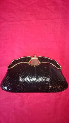 Hey, I found this really awesome Etsy listing at https://www.etsy.com/ie/listing/269542512/gold-clasp-evening-purse-retro-vintage