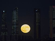 The moon rises in Madrid, Spain.
