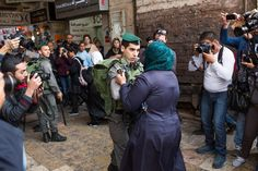 An Israeli border police officer confronts a Palestinian protester during a Land Day demonstration at the Old City of Jerusalem's Damascus Gate, 30 March. (Yotam Ronen / ActiveStills)