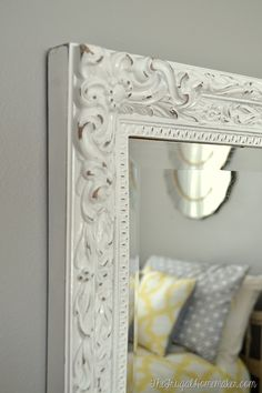 Painted and distressed yard sale mirror with @Rustoleum spray paint