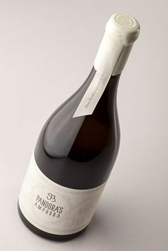 This bottle has classic lines and classy white wrapping. #bottles
