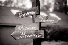 Virginia backyard wedding from Mike Topham Photography - I made these signs myself by printing the words, tracing them with mechanical pencil (to make an imprint) and then painted the outline with a sharpie paint pen.  Guests LOVE to know where to go and what to do! (Merriment was for our invitation - rather than 'reception to follow' we said 'feast and merriment to follow')