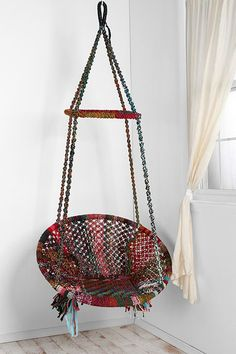 Get the support of a chair with the comfort of a hammock with this Marrakech chair made from hand-woven recycled cotton, it's a unique piece of furniture for any room or patio; featuring a durable bamboo frame and sturdy wood stretcher bar and heavy-duty hanging loop.