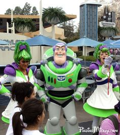 Buzz Lightyear and a pair of Space Rangers pose ofr photos in front of the Tomorrowland Terrace.