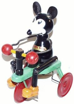 1932 Chein Ignatz Mouse Figure on Tricycle. Original leather ears, original and perfect decal. Shoes and wheels have been repainted, otherwise Excellent original condition. Decal on the front reads '
