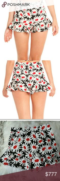 "Sassy little floral shorts NWOT Brand new without tags  Boutique item  Price is firm   Sassy little floral shorts featuring adorable ruffle detail at ends. Pair with your favorite top and heels or matching top is available in my closet.  Material 95%polyester 5%spandex  Elastic waist band Small Length 12"" Medium Length 13"" Large Length 14""  *Matching top sold separately in my closet*     Shorts"