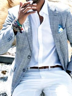Shop this look on Lookastic:  https://lookastic.com/men/looks/blazer-dress-shirt-chinos-pocket-square-belt-bracelet/12201  — White Chinos  — Dark Brown Leather Belt  — Grey Plaid Blazer  — White Dress Shirt  — White and Blue Print Pocket Square  — Multi colored Bracelet