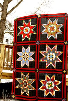 "Very cool Feathered Star by Cowgirl Boomer  (Just saw this quilt in the Fons & Porter's Love of Quilting Nov/Dec 2006 issue page 77.  It was called ""Black Feathered Star"" and was designed by them.  It measured 68 3/4"" x 101"".)"