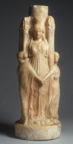 Ancient Roman Hekateion; a triple-bodied depiction of Hekate with the goddess's torch attribute. (Metropolitan Museum)