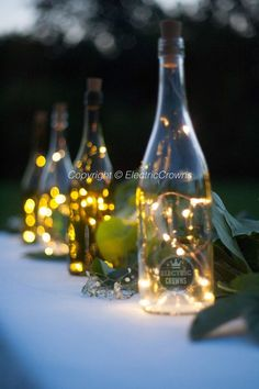 Wine bottle Lights | Wine bottle Crafts Wedding Table Decor | Wedding Centerpiece Wine Bottle Fairy Lights Centerpieces: https://www.etsy.com/ca/shop/ElectricCrowns