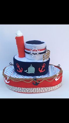 Baby shower boy baby shower centerpiece nautical diaper Nautical Diaper Cakes, Diaper Cake Boy, Nautical Baby, Baby Shower Presents, Baby Shower Gifts For Boys, Baby Boy Shower, Diaper Cake Centerpieces, Baby Shower Centerpieces, Christening Food