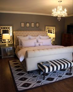 bedroom inspiration - sleigh bed, glass nightstands, mirrors behind night stands and matching side table lights