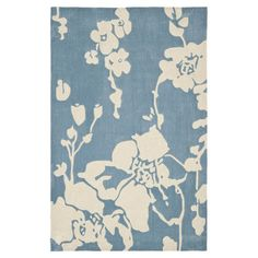 Anchor your living room seating group or define space in the den with this artfully hand-tufted rug, featuring a floral motif for garden-chic style....