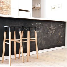 chalkboard kitchen island counter stools / kid friendly kitchen / island space for doodling to keep the kids busy while we cook