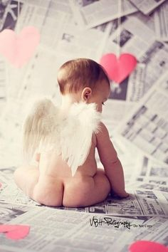 I like the newspaper as the floor/background..  the wings.. maybe for a girl...