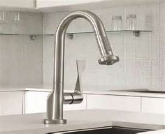 stainless steal to match everything else in the kitchen as well as having a handle that comes down so that you can move it around when doing dishes. easy to reach and use for people with disabilities