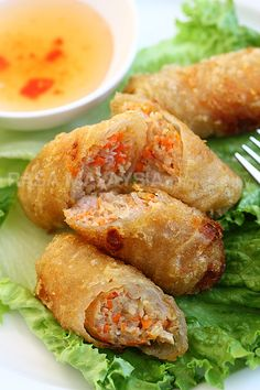 Vietnamese Spring Rolls - The filling is made of group pork, shrimp, crab meat, with shredded carrots in a deep-fried, crunchy, golden brown shell. #appetizer #seafood