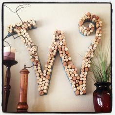 Wine corks hot-glued to a painted letter!