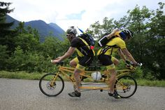 Sweden's Ake Johansson, left, and a friend climb L'Epine pass on a self-made tandem bicycle during the 19th stage of the Tour de France
