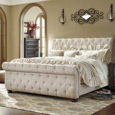 The upholstered bed has curved shape rolled edges with full button tufting in a linen color textured fabric. This bedroom is constructed with hardwood solids and birch veneers. Glam Bedroom, King Bedroom Sets, Bedding Master Bedroom, Home Bedroom, Bedroom Furniture, Bedroom Decor, Bedroom Ideas, Bedroom Modern, Bed Ideas