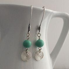 """Silver spiral earrings | $17 | #GiraffeDesigns #jewelry #handmade #handcrafted #earrings #silver #spiral #blue #teal"""