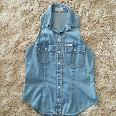 Guess sleeveless denim shirt Very form fitting and flattering!! Sexy cut in sleeve looks almost like a halter. Snaps down front and on pocket. Medium wash and weight. Guess Tops Button Down Shirts