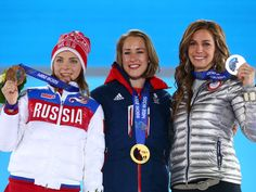 Sochi 2014 Day 9 - Medal Ceremony Bronze medalist Elena Nikitina (L) of Russia, gold medalist Lizzy Yarnold (C) of Great Britain and Silver medalist Noelle Pikus-Pace (R) of the United States celebrates on the podium during the medal ceremony for the Women's Skelton on day 9 of the Sochi 2014 Winter Olympics at Medals Plaza