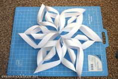 Easy 3D Paper Snowflake Tutorial -- made from regular printer paper or copy paper.  Hang from ceiling with pushpins and clear thread/fishing wire