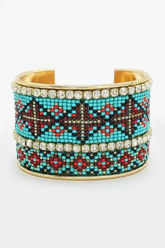 Pretty Turquoise Beaded Cuff - this would be super cute paired with a white pheasant top and jean shorts!