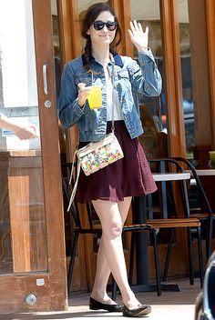 Emmy Rossum keeps it light and playful in a jean jacket, floral purse and oversized sunnies. So cute!