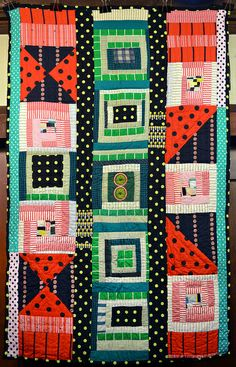 Eli Leon's improv quilt by daintytime, via Flickr. Eli gleaned the materials for the quilt from flea markets and thrift stores.