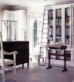 Great  book storage. Loving the batten on the ceiling too.
