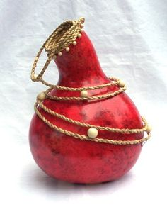 Red ink with sea grass and wooden beads. Gourd Art by Gloria Christian