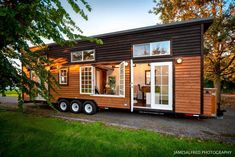 Tiny House with Double French Doors This foot tiny house on wheels is the perfect small space for a family or vacation rental. With double lofts and a ground floor master bedroom, this home is ideal for tiny living. Tiny House Big Living, Tiny House Cabin, Tiny House Plans, Tiny House Design, Tiny House Family, Tiny Houses For Rent, Tiny House Listings, Tiny House On Wheels, Little Houses