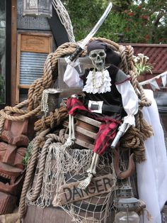 Pirate skeleton sitting on top of a barrel of rum... in my pirate backyard. Pirate party.