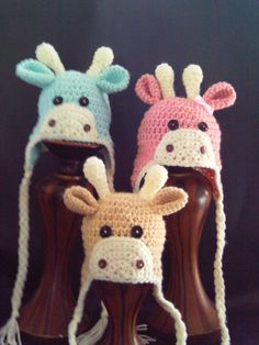 Baby Giraffe Earflap Hat - Sawyer wants this for his birthday.  The orange and white one.