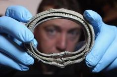 Darren Webster examines a silver arm-ring he discovered dating from 900 AD which is part of the Silverdale Viking Hoard on December 2011 in London, England. Vikings, Viking Arm Rings, Church Of Scotland, Viking Drinking Horn, Viking Clothing, Archaeological Discoveries, 1000 Years, Military Women, Celtic Art