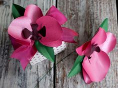 How to Make Tropical Paper Orchids: Use your finished orchids to top a gift, make a bouquet, or wear it on your sweater or in your hair. From DIYnetwork.com