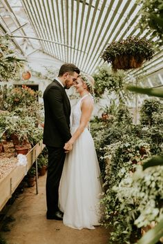 Getting married in a greenhouse is an efficient way to ensure your wedding is full of gorgeous greenery | photo by Vic Bonvicini Photography