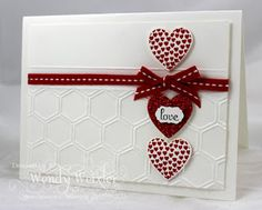 SU Stamps:  Hearts a Flutter, Fabulous Phrases.  SU Paper:  Whisper White, Red Glimmer. SU Ink:  Basic Black, Real Red.  SU Accessories:  Honeycomb Textured Impessions EF, Hearts a Flutter Framelites Die, Little Labels Punch Pack, Real Red Stitched Grosgrain Ribbon, Simply Scored.