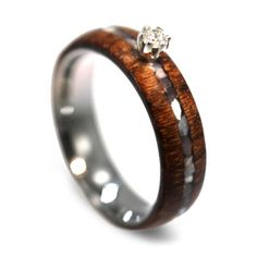 Wonderful womens ring with wood and mother of pearl inlay, Honduran Rosewood Engagement Ring with Prong Set diamond. The wood on this ring is waterproofe...