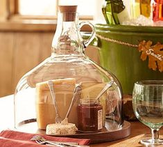 Wine Bottle Jug Cloche Cheese Platter potterybarn (there's a ton of DIY wine bottle cutting methods on pinterest ... this is amazing with a glass growler jug ... terrarium)