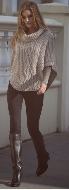Poncho style sweater, and boots.